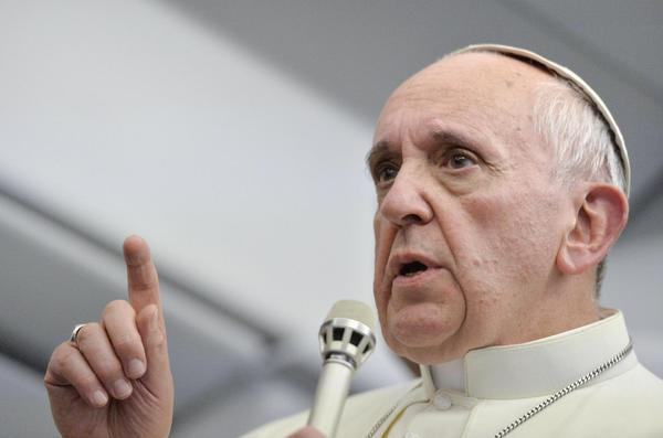 Pope Francis talks with journalists as he flies back to Rome following his visit to Brazil.
