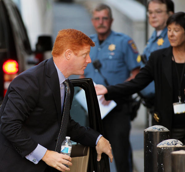 Former Penn State University football assistant coach Mike McQueary shows up as a witness for the prosecution Monday at a preliminary hearing for former Penn State president Graham Spanier, retired university vice president Gary Schultz and former athletic director Tim Curley at Dauphin County Courthouse in Harrisburg.