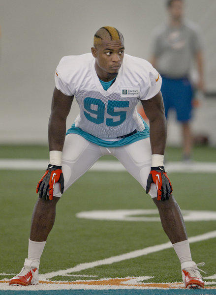 Rookie Dion Jordan in kick coverage during Miami Dolphins practice at the Dolphins training facility at NSU in Davie on July 24th,2013.