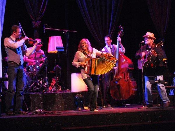 "LynnMarie Rink, center, and the band in ""Wrap Your Heart Around It"" at the Falcon Theatre."