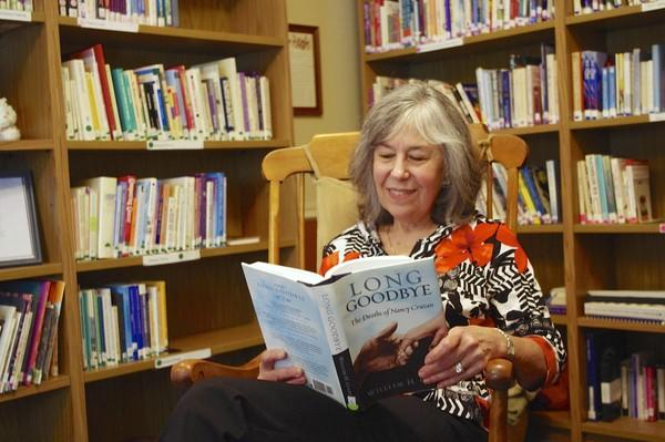Volunteer Julianne Testa sits in Fox Valley Volunteer Hospice's library and research center, which is open to the public.