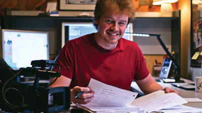 Tom Getty edits his screenplay at his home office in Westmont.