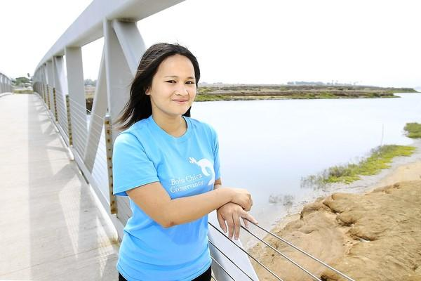 Ann Nghiem, 18, poses for a photo at the Bolsa Chica Conservancy in Huntington Beach on Wednesday. The conservancy will start their second year of its Youth Leadership in Environmental Action Program this August. The program will teach students about wetland ecology and life skills.