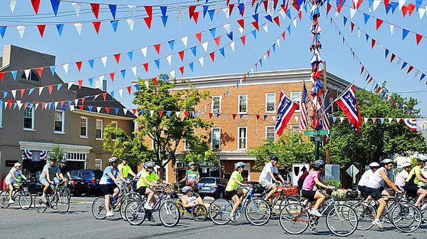 In this Herald-Mail file photo, bicyclists ride through the square in Greencastle, Pa., on the Tour of Antrim Township Bike Ride during the final day of the 37th triennial Greencastle. The Greencastle-Antrim community is counting down the days until the town launches its 38th triennial Old Home Week celebration Saturday through Aug. 11.