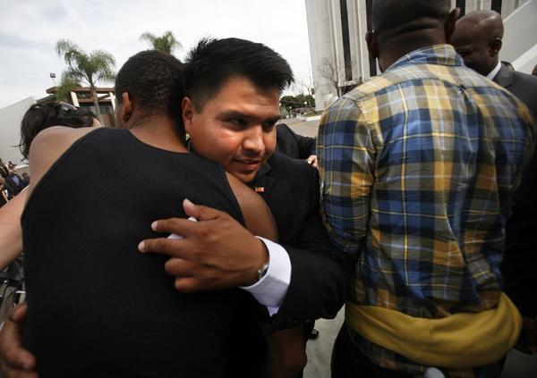 New Compton City Councilman Isaac Galvan, center, gets congratulations after he was sworn in.