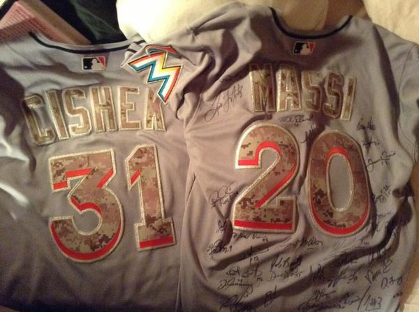 Steve Cishek sent Julia Massi, on her second tour of duty in Afghanistan, a pait of Miami Marlins camouflage jerseys.
