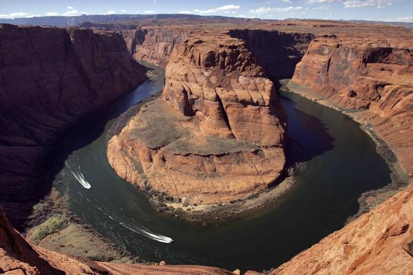 More frequent and intense droughts in the West may result in legal battles over the allocation of Colorado River water. Above, the river's Horseshoe Bend in Page, Ariz.