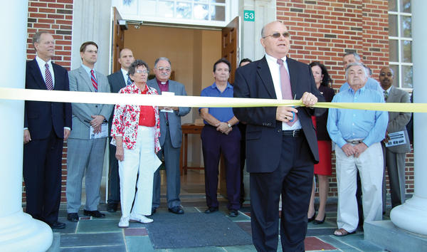 Winebrenner Theological Seminary President David Draper cuts a ribbon Monday morning to ceremonially open the school's new campus in Scotland, Pa.