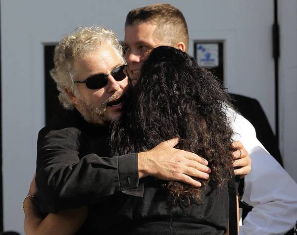 """Actor William Petersen embraces a visitor Monday outside the wake for Dennis Farina at Montclair-Lucania Funeral Home in Chicago. Petersen and Farina worked together in the movies """"Manhunter"""" and """"Thief."""""""