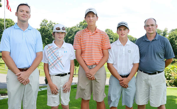 Three age-group champions were honored after Monday's Tri-State Junior Golf Association tournament at Fountain Head Country Club. Fountain Head apprentice golf pro Jeremy Brown (left) congratulates Noah Reeder (12-13 winner), Nick Franki (14-15) and Ryan Mumaw (16-18) along with event sponsor Keith Staley.
