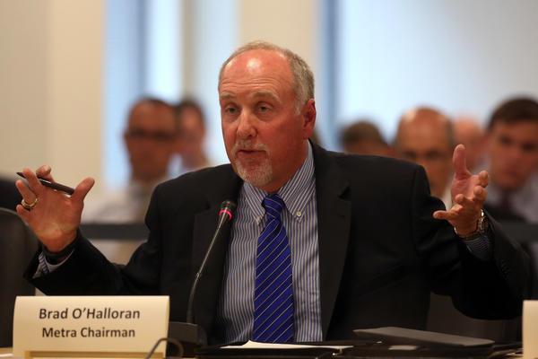 Metra Chairman Brad O'Halloran received nearly $22,000 for his service as an elected trustee in Orland Park despite a state law banning Metra board members from receiving a paycheck from any other government post, according to records from the southwest suburb.