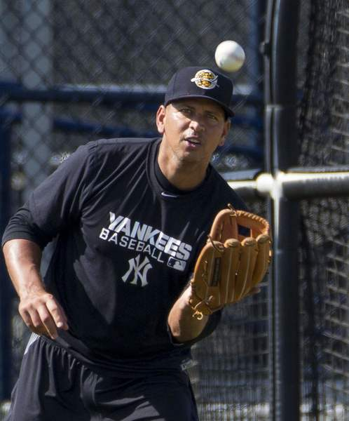 Yankees' Alex Rodriguez catches a ball while playing long toss at the teams minor league complex during a rehab assignment in Tampa.