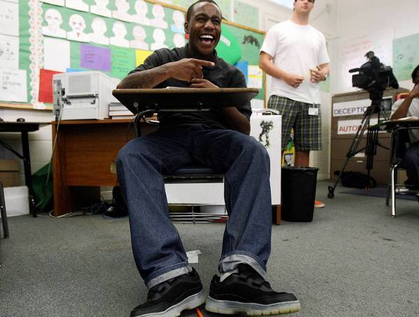 Camp Afflerbaugh probationer Marquis, 16, shares a moment with other students during Freedom School. The Times had permission from Los Angeles County Juvenile Court to use the images and first names of the boys in the story.