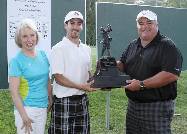 Golfer Chris Russo (center) is presented the tournament trophy by Glendale Parks & Open Space Foundation President Dottie Sharkey and Rick Dinger at the Oakmont County Club in Glendale after winning the second annual Glendale Golf Championship on Monday. (Tim Berger/Staff Photographer)