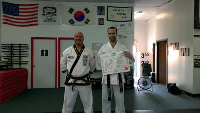 Richard Stewart (right), who received his first-degree black belt, pictured with Chief Instructor Christopher Miller.