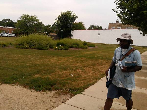 A postal worker strolls by 611 Green Bay Road, a property the village is hoping to sell for redevelopment. The developer, Lexington Homes, was recently given a third extension on its due diligence review.