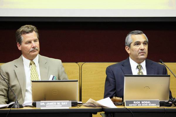 School District 230 Superintendent James Gay, left, and School Board President Rick Nogal said they were pleased with the district's new three-year contract for teachers. The board approved the contract on July 25.