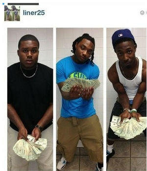 Alabama freshman Dee Liner, left, poses with some buddies and lots of cash in a since-deleted Instagram photo.