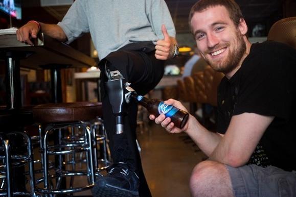 Opening a beer bottle on Levi Kane's fake leg