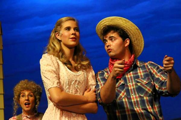 Laurie Edwalds as Aunt Eller; Lis Coster as Laurie and Cullen Rogers as Curly in 'Oklahoma!'