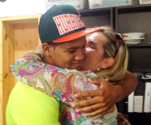 Winter Park defensive end Trent Harris hugs his mom Betsy Harry after he committed to the Miami Hurricanes.