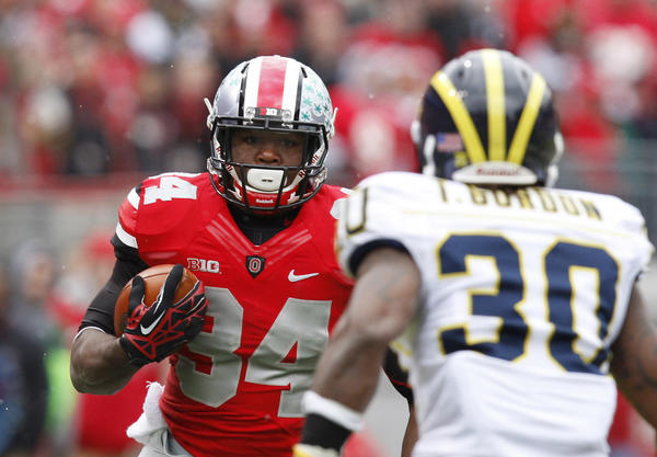 Ohio State Buckeyes running back Carlos Hyde (34) runs upfield toward Michigan Wolverines safety Thomas Gordon (30) during their game last season.