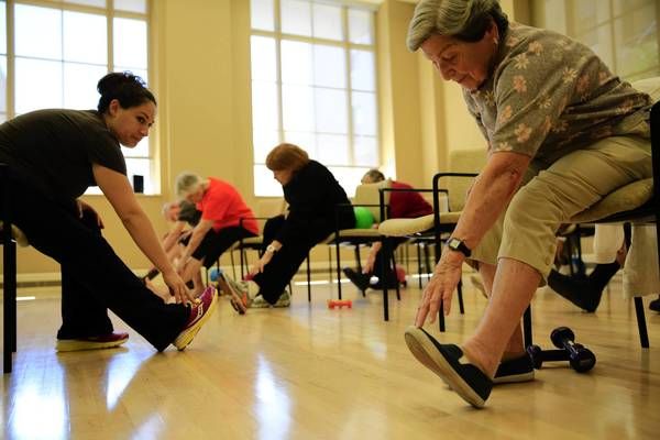 "Fitness instructor Chrissy Fernandez, left, teaches a fitness class for senior citizens living at the Mather, an Evanston retirement community. One expert says exercise can improve ""flexibility, balance, strength (and) mood,"" even for previously sedentary people."
