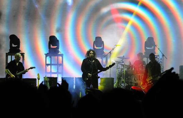 The Cure lead singer and guitarist Robert Smith performs during a show in Asuncion, Paraguay on April 9, 2013. The Cure is a headliner at this year's Lollapalooza.