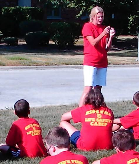 Betsy Dine works with children at the Kids' Fire and Life Safety Camp in July. Dine was recently hired as the new public education coodinator for the Orland Fire Protection District.