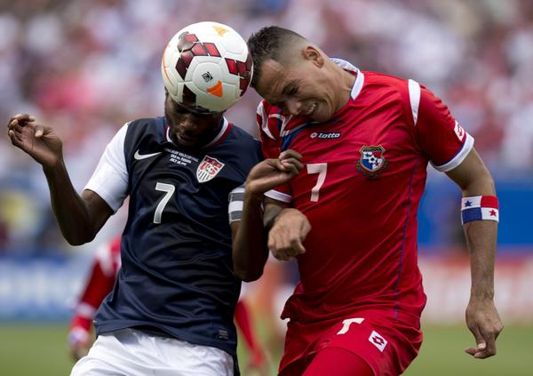 DaMarcus Beasley (L) of the US and Blas Perez of Panama fight for the ball during the CONCACAF Gold Cup soccer final on July 28, 2013 at Soldier Field in Chicago. The US won 1-0. AFP PHOTO/Don EmmertDON EMMERT/AFP/Getty Images ORG XMIT: 163747794