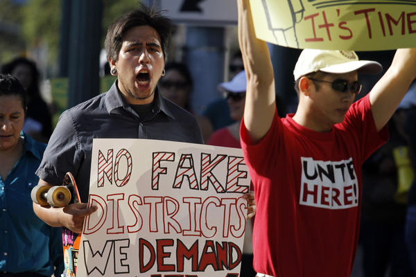 Anaheim protester makes his feelings known about the council's decision on districts.