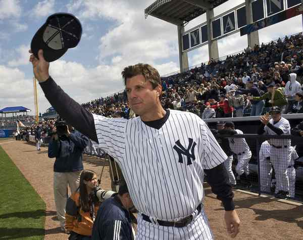Former New York Yankees' Tino Martinez waves to the crowd before the Yankees home opener spring training baseball game against the Pittsburgh Pirates at George M. Steinbrenner Field in Tampa, Florida in this March 3, 2010 file photo. Miami Marlins batting coach Tino Martinez resigned on July 28, 2013amid claims he was abusive to several players, according to the Miami Herald and MLB.com. Martinez, a first-year coach and retired first baseman for the New York Yankees and Seattle Mariners, handed in his resignation after the agent for rookie second baseman Derek Dietrich contacted the Marlins over an incident that reportedly took place several months back, the Herald said. REUTERS/Steve Nesius/Files (UNITED STATES - Tags: SPORT BASEBALL) ORG XMIT: TOR301