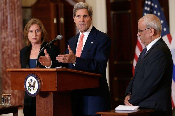 Secretary of State John F. Kerry, flanked by Israeli Justice Minister Tzipi Livni, left, and Palestinian chief negotiator Saeb Erekat, discusses the Middle East peace talks at a news conference in Washington.