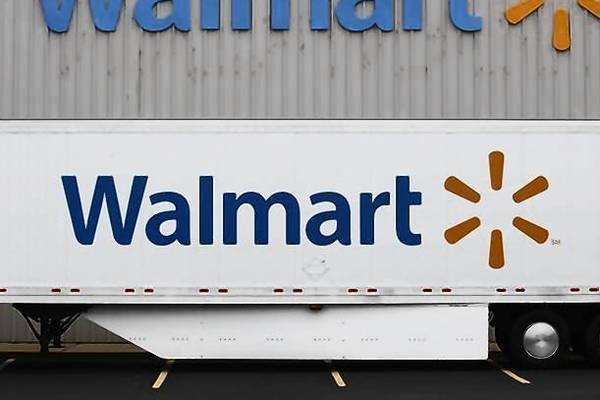 The Wal-Mart company logo is seen outside a Wal-Mart Stores Inc company distribution center in Bentonville, Arkansas.