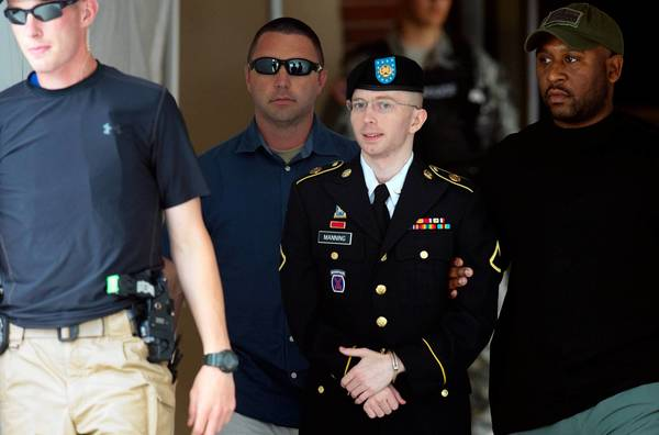 Pfc. Bradley Manning leaves a military court facility Tuesday after hearing his verdict in the trial at Fort Meade, Md. A military judge convicted Manning of espionage, leaving him facing a lengthy jail term despite clearing him on the most serious charge that he 'aided the enemy.'