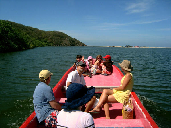 Taking a boat ride on the Rio San Nicolas, which forms the northern boundary of the Las Alamandas resort in Mexico.