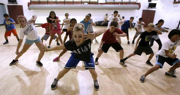 Hip-hop dance instructor Kelli Erdmann, center, goes through a routine with Spartan All-Stars All-Sports Campers at La Cañada High.