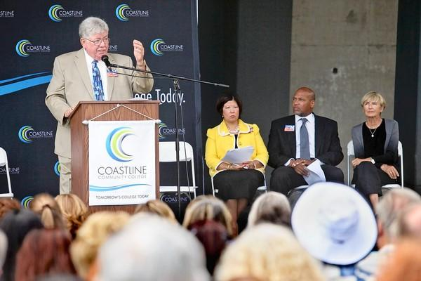 Jim Moreno, left, Coast Community College District trustee, speaks during a ribbon-cutting ceremony for Coastline Community College's new Newport Beach campus.