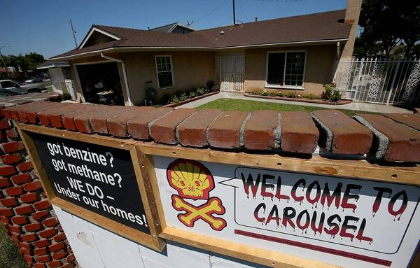Signs warning of severe ground contamination greet visitors entering the Carousel residential subdivision in Carson. City officials have declared a local emergency over the contamination.