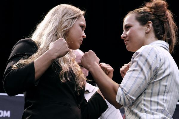 Things got personal between Glendale Fighting Club-trained Ronda Rousey, left, and Miesha Tate at the Ultimate Fighting Championship's World Tour 2013 press conference at Club Nokia. Rousey will defend her UFC women's bantamweight championship against Tate on Dec. 28 at UFC 168 in Las Vegas live on pay-per-view.