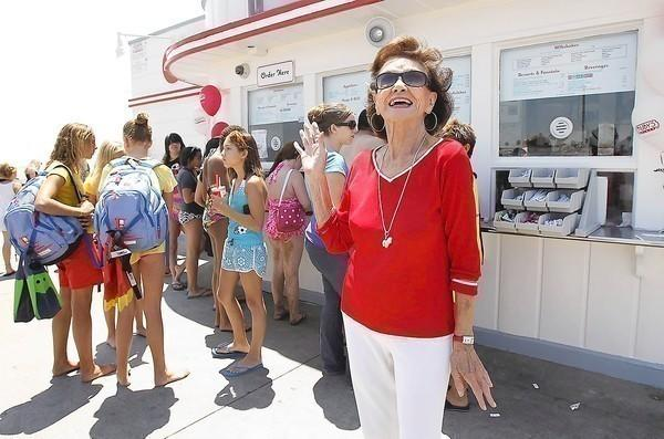 Ruby Cavanaugh, the original Ruby, waves to guests as she made a guest appearance at the original restaurant at the end of Balboa Pier on Monday. The Irvine-based chain has some other changes coming ahead to fit the changing times.