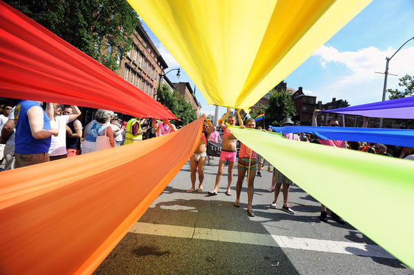 Members of the LGBT community match in the Baltimore Pride Parade, sponsored by the Gay, Lesbian, Bisexual and Transgender Community Center of Baltimore (GLCCB).