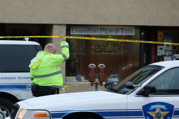 Evanston police at a downtown tobacco shop where two brothers were found fatally shot, according to relatives.