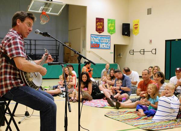 Children's performer Jim Gill plays a concert at Chesterbrook Academy Elementary School in Naperville to benefit the Humanitarian Service Project.