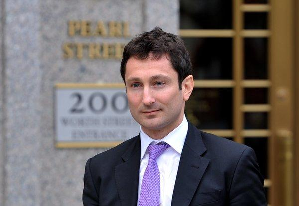 Former Goldman Sachs trader Fabrice Tourre leaves for a lunch break from federal court in New York.