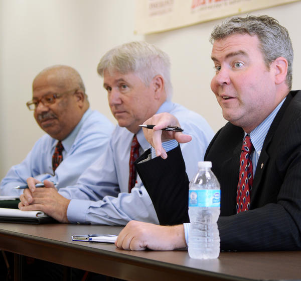 Assistant Commissioner for Maryland Occupational Safety & Heath Eric Uttenreither, right, along with co-workers Michael Penn and Keith Owens address issues about health and safety standards, rules and regulations at a meeting Wednesday at Barr Construction Institute in Hagerstown.