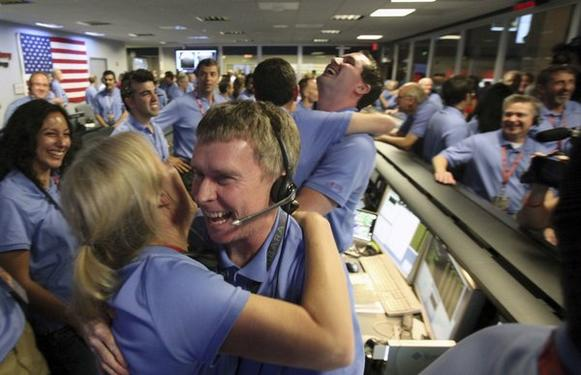 "Curiosity survives the dreaded ""Seven Minutes of Terror"" and lands successfully on Mars. Staffers at the Jet Propulsion Laboratory in La Canada Flintridge (and people around the world) celebrate."