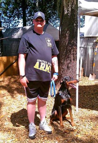 Chuck Spires with his service dog in 2012. Diagnosed with multiple brain injuries after serving in Iraq, it was a 50-lb. weight gain that prompted deeper investigation, which revealed damage to his pituitary gland.