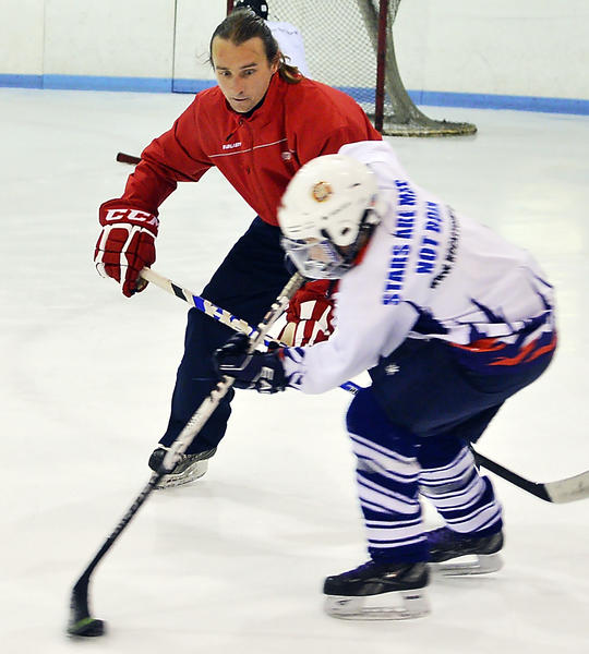 Tomas Mahovsky directs hockey campers Tuesday during Czech International Hockey Camp at Hagerstown Ice & Sports Complex at Fairgrounds Park. Mahovsky came from Czech Republic to teach at the camp.