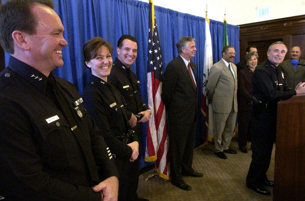 Hermosa Beach has selected LAPD Commander Sharon Papa as its new police chief. She is shown here, second from left, being promoted to deputy chief by former LAPD Chief Bill Bratton.